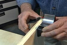 slipping a positioning clamp on a base panel