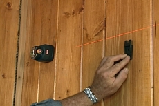 aligning wall cabinet clips with a laser level