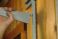 inserting shelf supports in the standards