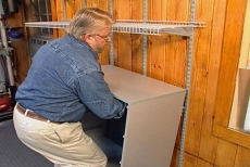 inserting the hanging cabinet grips into the shelf standards