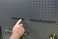 pushing the screw head to lock the tool holders in place