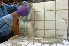 Using a float to push grout into the joints