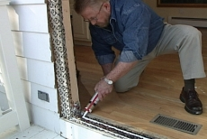 Applying silicone sealant to the threshold