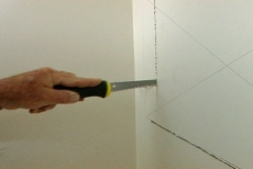 Cutting an access opening with a wallboard saw