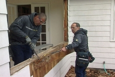 prying off the damaged sheathing