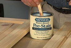 Applying wood conditioning pre-stain
