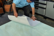 Applying fiberglass paper to the Thin-Skin Adhesive