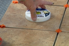 Using a tile puck to check the tile height