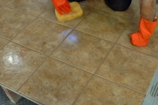 Cleaning the tile with long strokes
