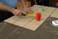 Setting tile with a plastic mallet