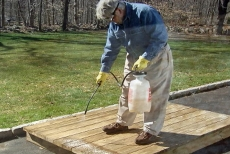 spraying brightener on the damp deck