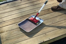 using a paint tray for the deck restoration sealer