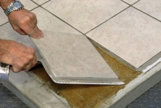 lifting removable tile installation with a pry bar