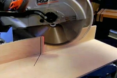 making a cut with the miter saw