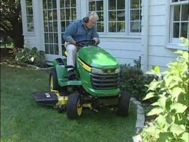 mowing the lawn with a riding mower