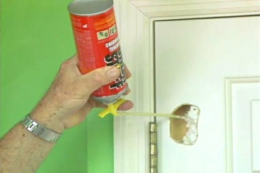 filling the hole in the door with aerosol foam insulation