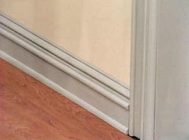 Baseboard and door casing molding with detail added