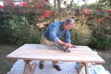 sanding an outdoor table