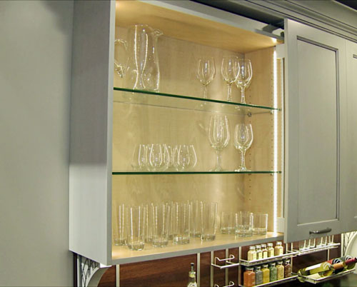 Glass kitchen cabinet interior with thin profile low voltage led lighting