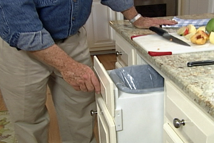 How to Make a Pull-Out Trash Bin • Ron Hazelton Under Sink Trash Pull Outs For Kitchen on under sink pull out drawer, under sink organizer kitchen, under sink organization, under sink water filter system, under sink storage shelves,